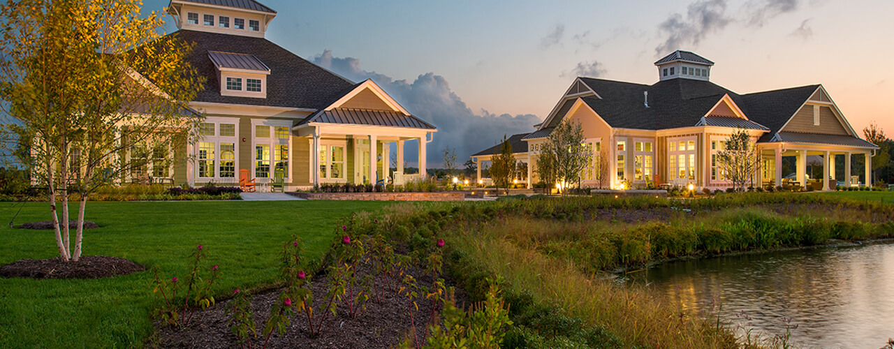 millville by the sea lifestyle center at dusk 1280x500